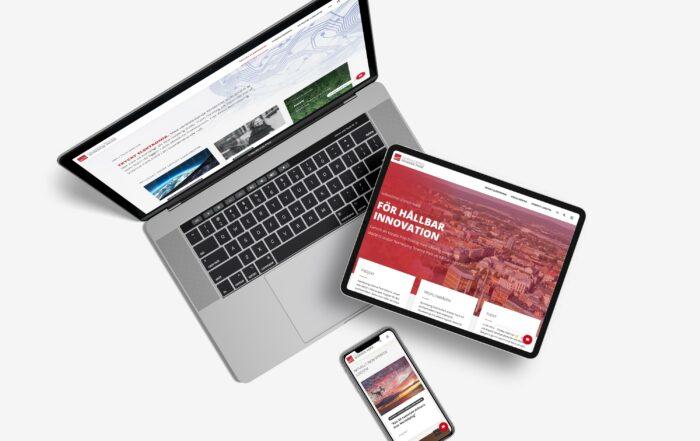En laptop, en surfplatta och en mobil som visar Norrköping Science Parks hemsida som utvecklades av Bishop Media